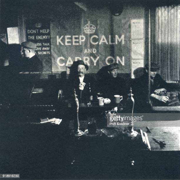'Carry On' 1941 Men sit in a local pub and follow the government's advice to 'Keep Calm and Carry On' From Air of Glory by Cecil Beaton [His...