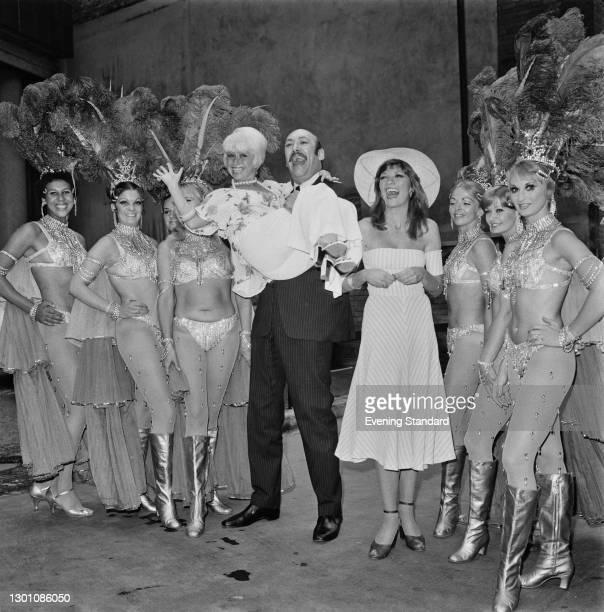 'Carry On' actors Barbara Windsor and Bernard Bresslaw pose with Trudi Van Doorn, aka Geraldine Gardner and a group of showgirls, UK, 18th July 1973.