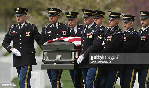 A carry team from the Army's 3rd US Infantry Regiment or The Old Guard move the casket of Korean War solider US Army Sgt Wilson Meckley Jr during his...