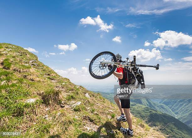 carry the bike to the summit, italy - cycling helmet stock photos and pictures