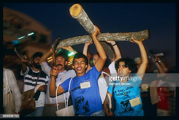 Carrying a roughhewn wooden cross delegates from the ecclesial base communities of Liberation Theology come together for their sixth meeting...