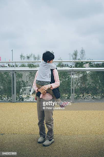 carrying child - peter lourenco stock pictures, royalty-free photos & images