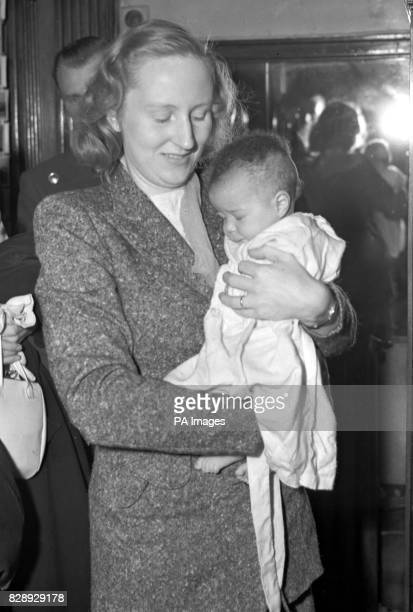 Carrying her three month old daughter Jacqueline Mrs Ruth Khama is pictured at the Grosvenor Court Hotel London