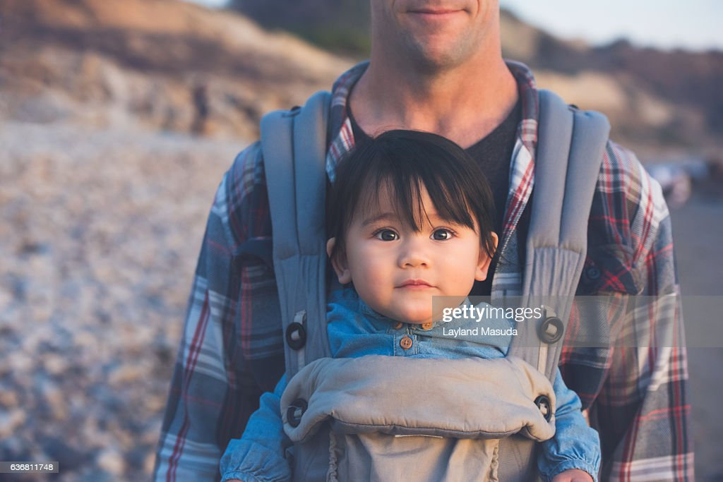 Carrying His Baby Girl : Stock Photo