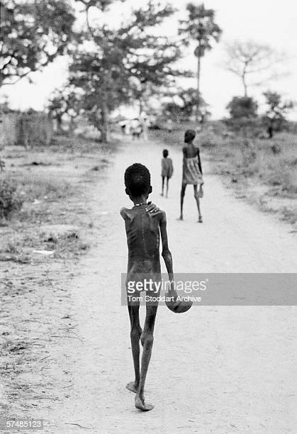 Carrying his only possession a food bowl an emaciated boy approaches the Medecins Sans Frontieres feeding centre in Ajiep southern Sudan in 1998