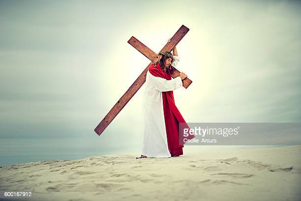 Carrying his own cross, he went out to Golgotha