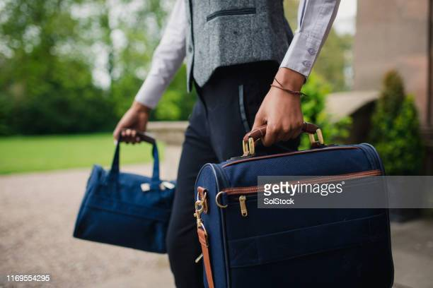 carrying hotel guest's luggage - unrecognisable person stock pictures, royalty-free photos & images