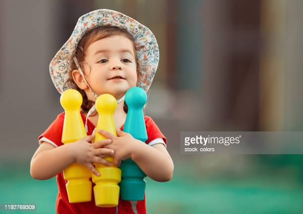 carrying my toys in the garden - bowl stock pictures, royalty-free photos & images