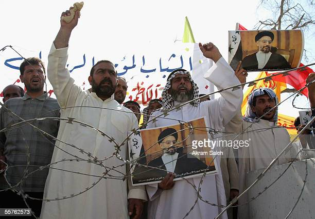 Carrying pictures of Shiite cleric AbdulAziz alHakim Iraqi Shiites chant slogans as they take part in a demonstration in support of Iraq's new...