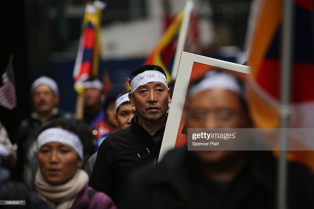 Carrying posters of people who have self-immolated themselves, protestors march down 42nd street to the United Nations General Assembly Building in recognition of International Human Rights Day on December 10, 2012 in New York City. Chinese-occupied Tibet has witnessed over 90 Tibetans self-immolating themselves in protest to China since 2009. Tibetans, their supporters and human rights activists are calling for immediate action by the United Nations and world governments to pressure China to resolve the issue.