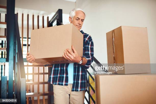 carrying precious cargo aka memories - working seniors stock pictures, royalty-free photos & images