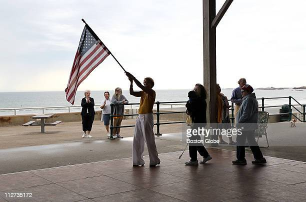 Carrying the flag during the final songs Eva Price leads the march around the dance floor She is followed by Quincy sisters Frances Kennedy and Ellie...