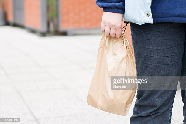 Carrying the paper bag