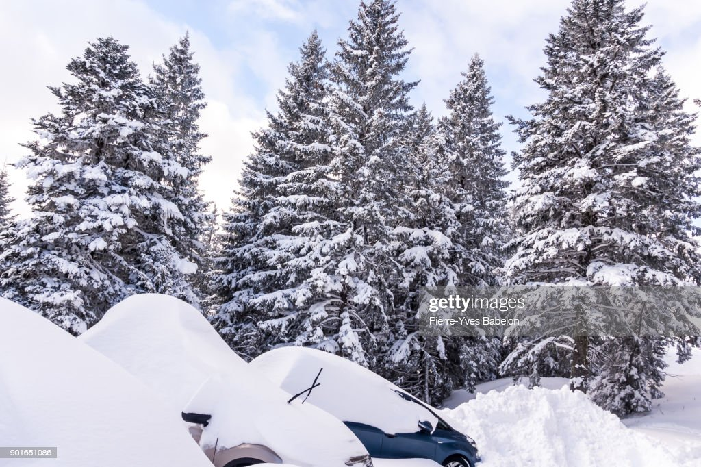 Cars almost totally buried under a snow at the alpin ski station