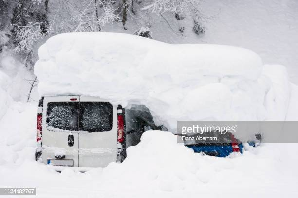 Cars almost vanished under deep snow