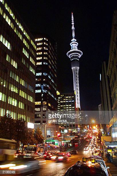 Cars and buses make their way up and down Victoria Street in central Auckland past the 328 metre Sky Tower the tallest building in the Southern...