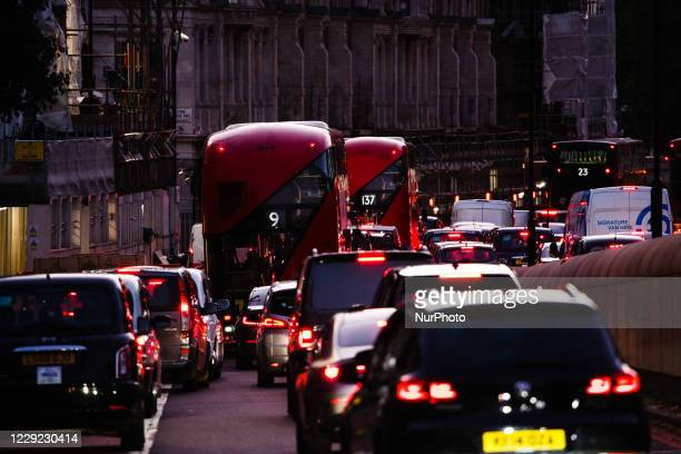 Cars and buses queue in a long traffic jam on Knightsbridge in London, England, on October 22, 2020. Government plans to expand the London Congestion...