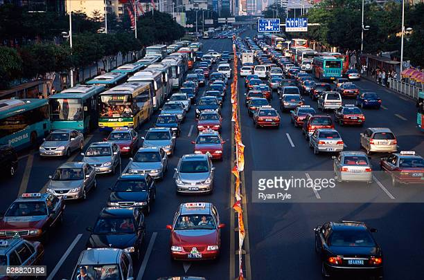 Cars and buses travel along a major roadway in Shenzhen The traffic in Shenzhen is getting worse as the economic boom in China has led to a rapid...