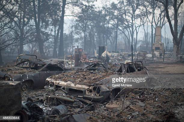 Cars and homes that burned in the Valley Fire are seen on September 15 2015 in Middletown California The 104squaremile fire is only 15 percent...