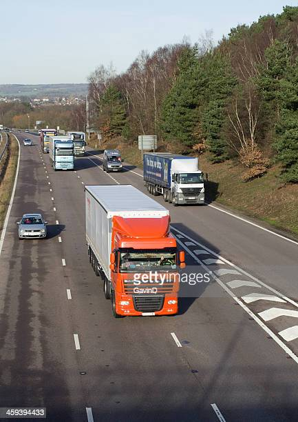 cars and lorries head east along m20 motorway - ashford kent stock photos and pictures