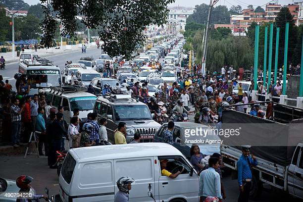 Cars and motorbikes line up as drivers wait for the opening of a fuel pump at a petrol station in Kathmandu on September 30 2015 Nepalese are facing...