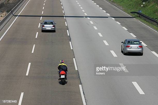 Cars and motorcycle on a quiet four-lane highway