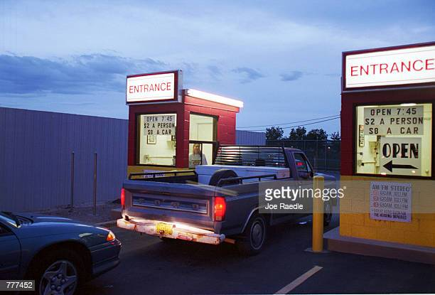 Cars and pickup trucks enter the Fiesta drivein movie theater August 10 2000 in Carlsbad New Mexico The death of the drivein has been proclaimed far...