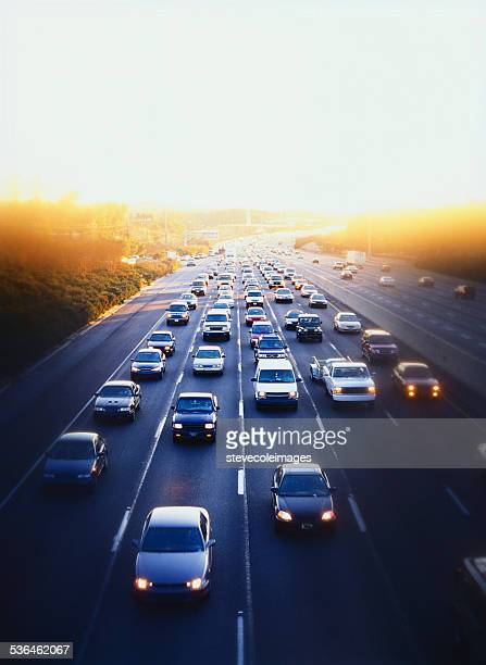 cars and simi-trucks on expressway in downtown atlanta, georgia - traffic stock pictures, royalty-free photos & images