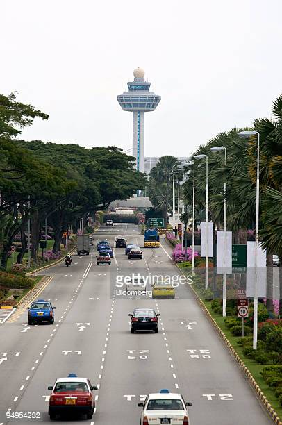Cars and taxis approach Changi Airport in Singapore on Monday Sept 7 2009 Karl Ong hoped to find a quiet spot on his Singapore Airlines Ltd flight...
