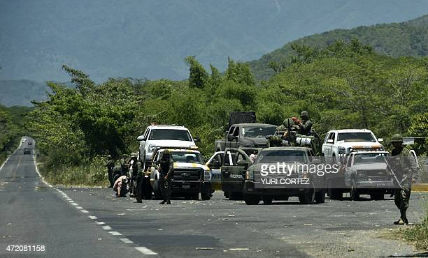 Cars and trucks involved in a fight with Mexican army members are removed from the site in Villa Purificacion Jalisco State Mexico on May 3 2015...