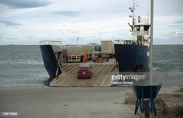 Cars and trucks loading onto a ferry