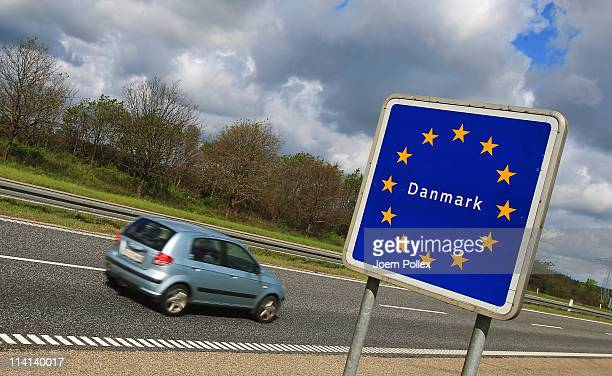 Cars and trucks pass the GermanDanish border on May 13 2011 near Flensburg Germany Denmark has introduced border controls at its borders to Germany...