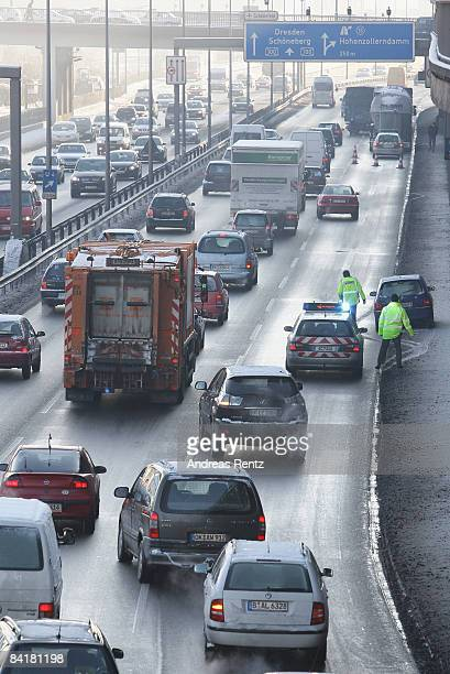 Cars and trucks stuck in a traffic jam on January 6 2009 in Berlin Germany Freezing conditions with snow ice and temperatures at 20 degrees below...
