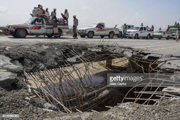 Cars and trucks wait in line to pass over a bridge that was hit by an airstrike in 2016 This road is one of four roads linking Al Hudaydah with the...