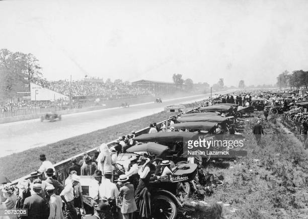 Cars approach the finishing line of the 500 mile race at the Indianapolis Motor Speedway in Indianapolis, Indiana, which opened in 1909.