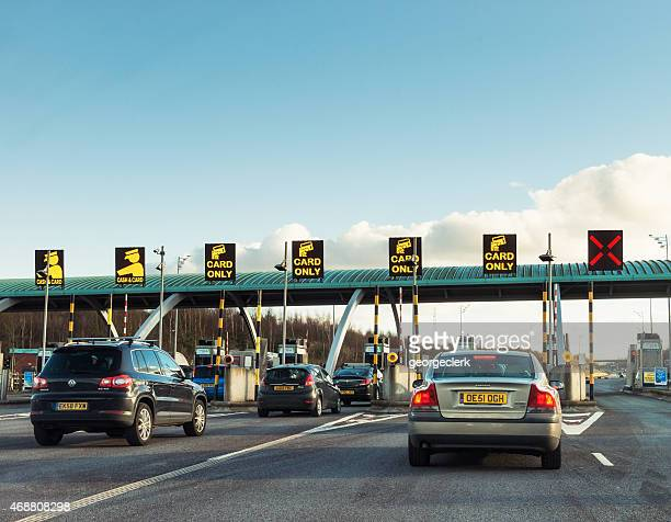 Cars approaching road toll gates