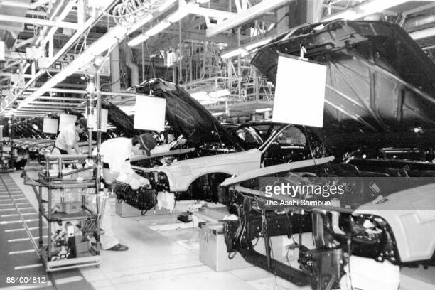 Cars are assembled on the production line at Toyota Motor Co's Tahara Plant on April 13 1992 in Tahara Aichi Japan