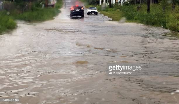 Cars are blocked by a road flooded by Hurricane Irma on September 6 in St John's Antigua and Barbuda After making landfall just before 0600 GMT in...