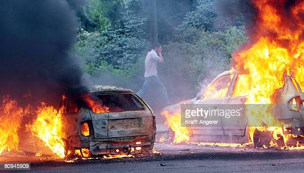 Cars are burning in the Saarlandstrasse during the May Day Demonstration on May 1 2008 in Hamburg Germany The cause of the fire remains unknown
