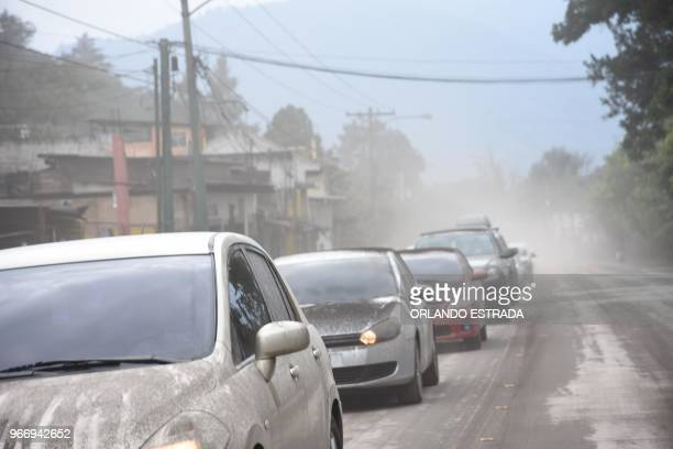 Cars are covered in ashes from the Fuego Volcano in Antigua Guatemala Sacatepequez department 45 km southwest of Guatemala City on June 3 2018