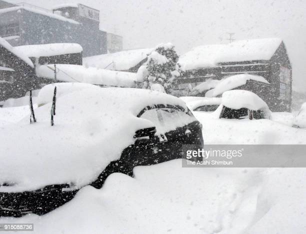 Cars are covered with snow on February 6 2018 in Fukui Japan The SelfDefense Forces were called out to rescue around 1000 vehicles stranded in heavy...