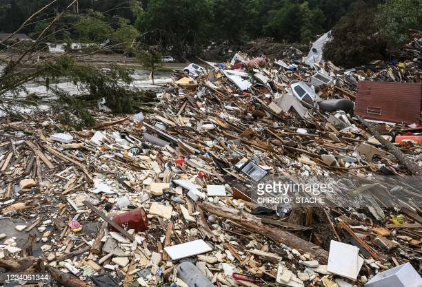 Cars are covered with wood an rubble in Altenahr, Rhineland-Palatinate, western Germany, on July 19 after devastating floods hit the region. - The...