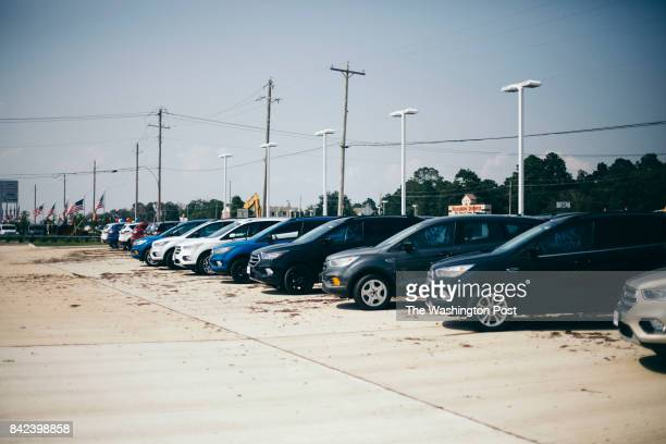 Cars are damaged from flood water caused by Hurricane Harvey on the sales lot at McRee Ford in Dickinson Texas on September 1 2017 John Taggart for...