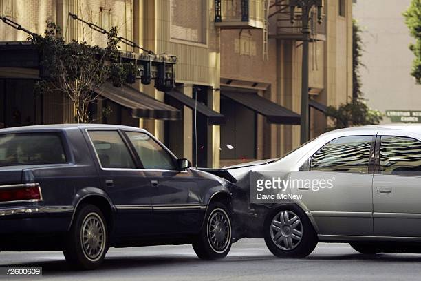 Cars are deliberately crashed during the shooting of an auto insurance commercial onlocation downtown on November 18 2006 in Los Angeles California A...