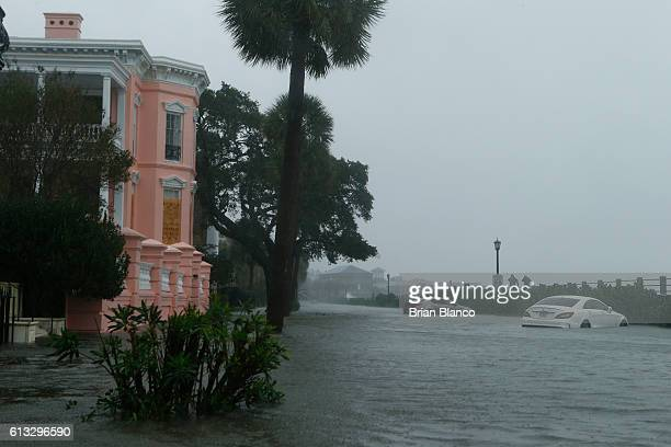 Cars are flooded along E Battery Street adjacent to White Point Gardens in the wake of Hurricane Matthew on October 8 2016 in Charleston South...