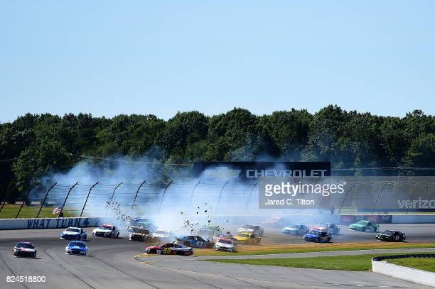 Cars are involved in an ontrack incident on the first lap of the Monster Energy NASCAR Cup Series Overton's 400 at Pocono Raceway on July 30 2017 in...