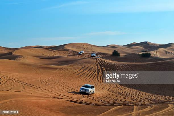 CONTENT] Cars are lined up in the course of desert safari in Dubai Where they do dune bashing and some adventures
