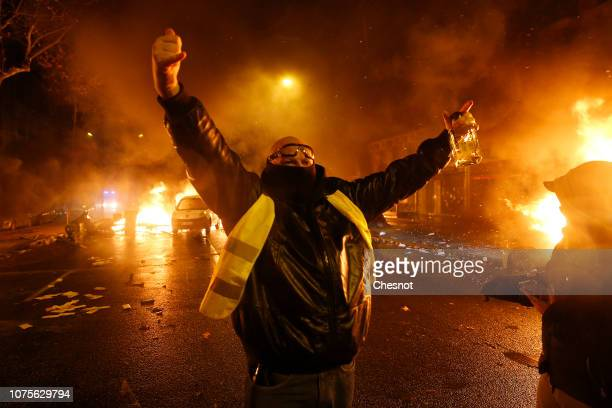 Cars are on fire during the demonstration of the yellow vests on the Kleber avenue on December 01 2018 in Paris France 'Yellow Vests' is a protest...