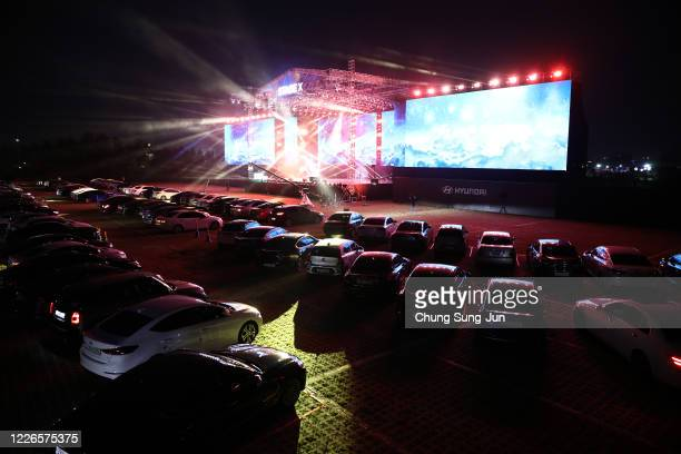 Cars are parked at a drive-in musical operation by Hyundai Motor at Stage X Drive-in Concert as South Koreans take measures to protect themselves...