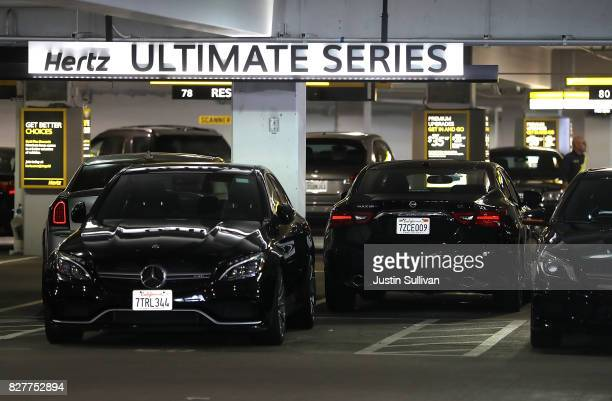 Cars are parked at a Hertz rental car office on August 8 2017 in San Francisco California Rental car companies are seeing a drop in earnings and...